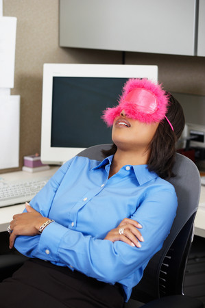 Business woman sleeping at her desk Stock Photo