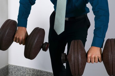 Office worker weightlifting
