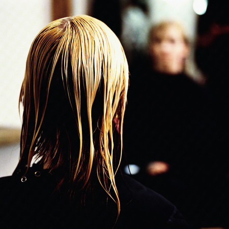 Woman at hairdressers Standard-Bild