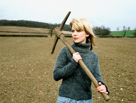 Woman holding a pick