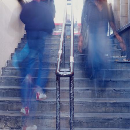 Blurred people on stairway 写真素材