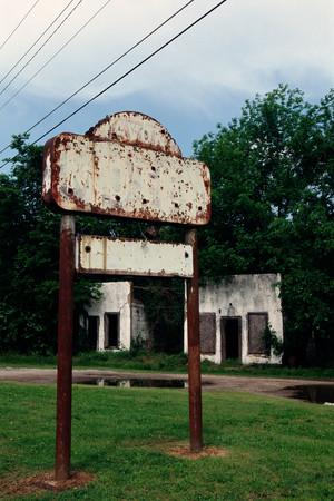 Rusting sign near building 写真素材