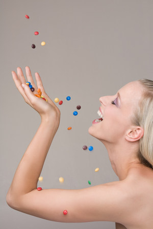 Young woman and falling candy