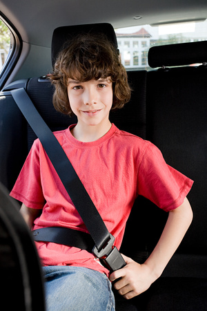Portrait of a boy wearing a seatbelt