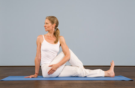 A mature woman in a yoga position