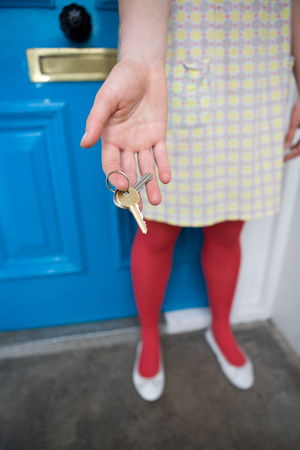 Woman holding door keys