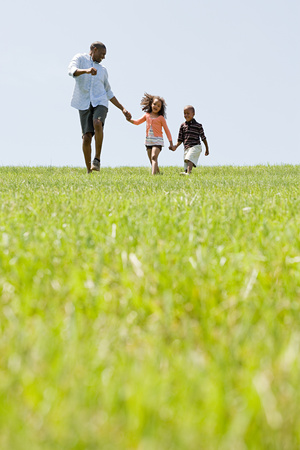 Father and children in field Stock Photo