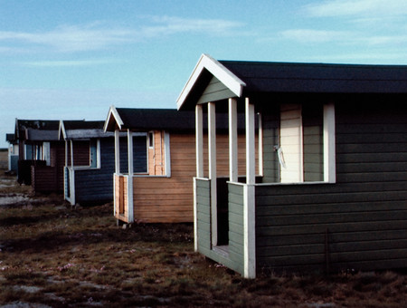 Row of beach huts background. Stock Photo