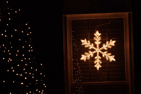Illuminated star shape in window