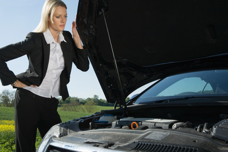 A woman having automobile trouble