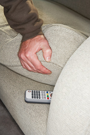 Person finding remote control