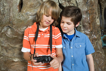 Two boys looking at a camera Imagens