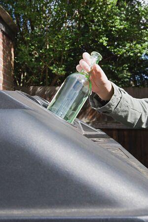 Recycling a wine bottle 版權商用圖片