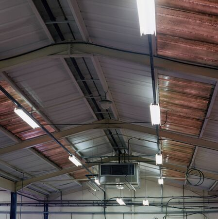 Fluorescent lighting on factory ceiling