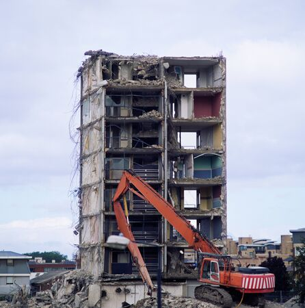 Crane demolishing a building