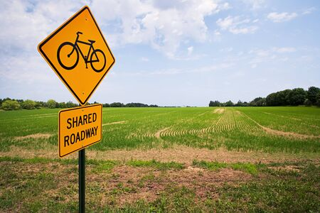 Road sign by a field