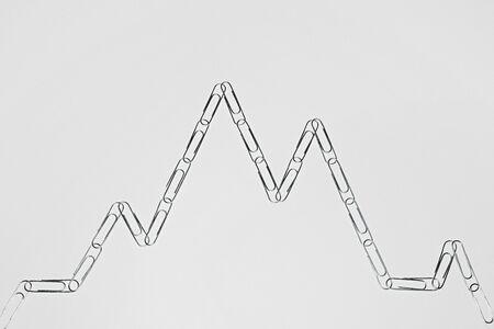 Paper clips arranged like a graph Stock fotó
