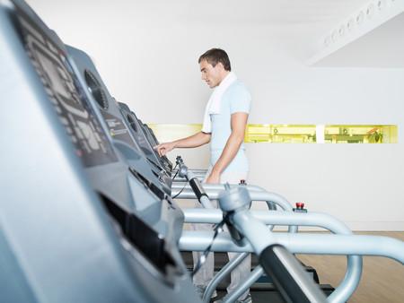 Mann on treadmill in health club