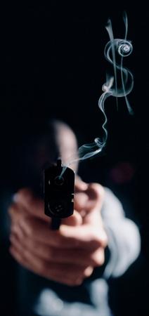 Dollar sign in gun smoke