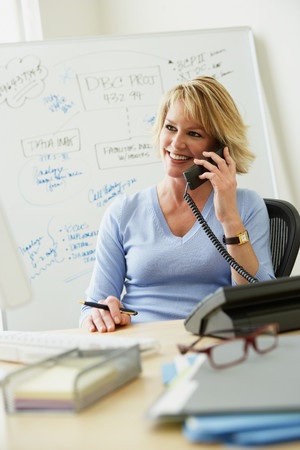 Office worker using telephone Stock Photo