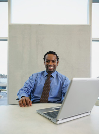 Man at his desk with laptop Stock Photo