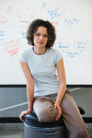 Woman in front of whiteboard
