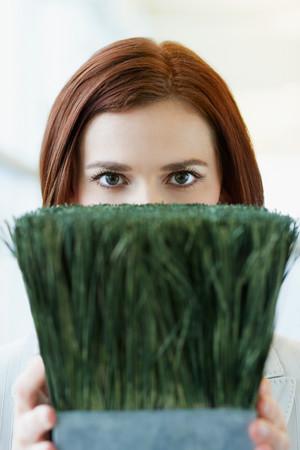 Woman holding pot plant Imagens