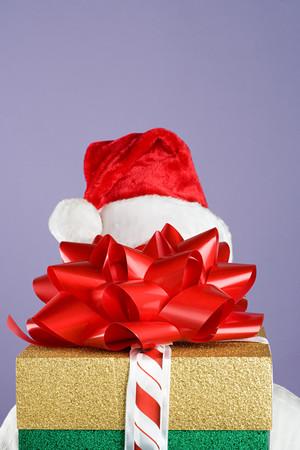 Person hiding behind presents