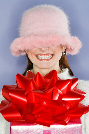 Fluffy hat covering womans face