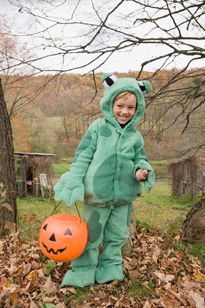 Boy in a frog costume