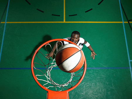 Basketball player scoring Stock Photo