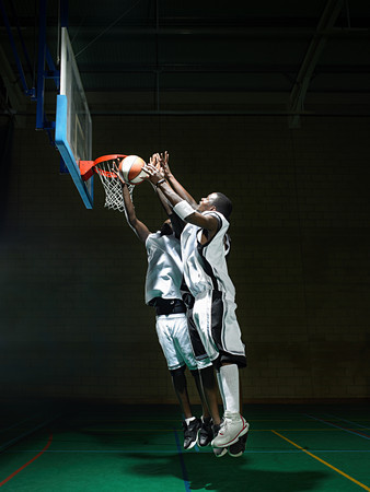 Basketball players by hoop
