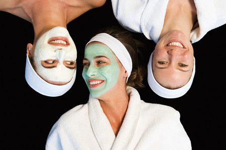 Friends wearing facial masks