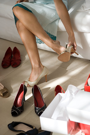 Woman putting shoes on Stock Photo