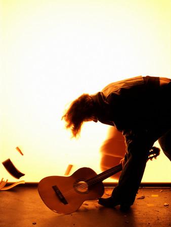 Man smashing guitar