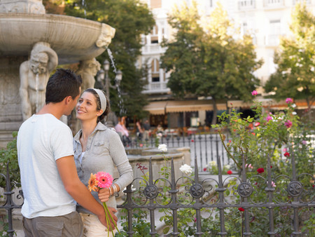 Romantic couple in town square Stock Photo - 116560293