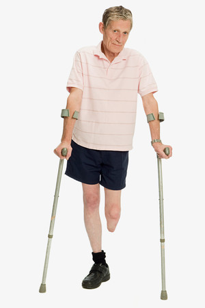 Male amputee using crutches