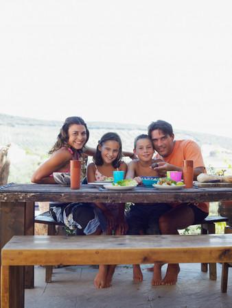 Family having meal outdoors Stockfoto
