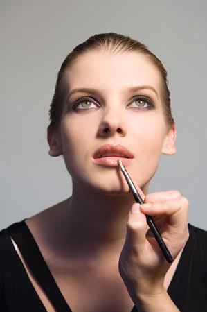 Woman having lip gloss applied Stock fotó