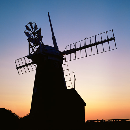 Silhouette of a windmill at sunset