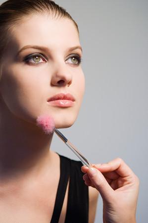 Woman having make up applied Stock fotó