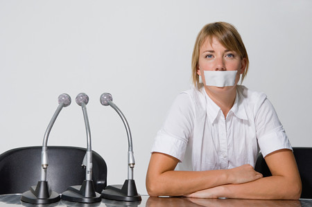 Businesswomans mouth covered with a plaster