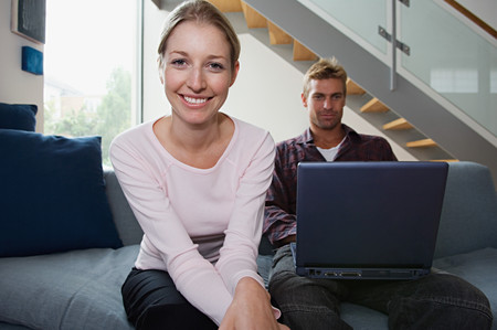 Couple with a laptop computer on sofa Stock Photo