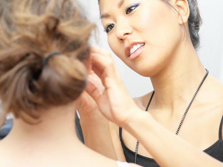 Make-up artist working on model 写真素材