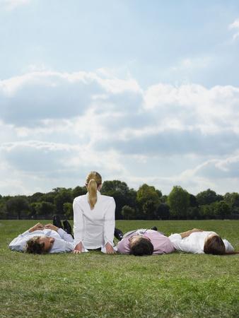 Office workers relaxing in a field Reklamní fotografie