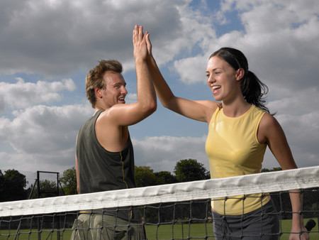 Tennis players doing a high five