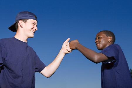 Two teenage boys celebrating
