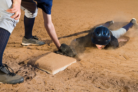 Two teenage boys playing baseball