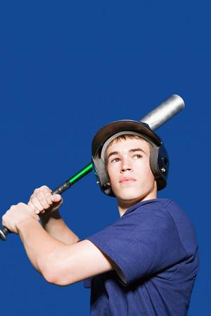 Teenage boy about to swing baseball bat