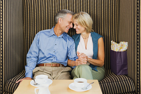 Loving couple having coffee